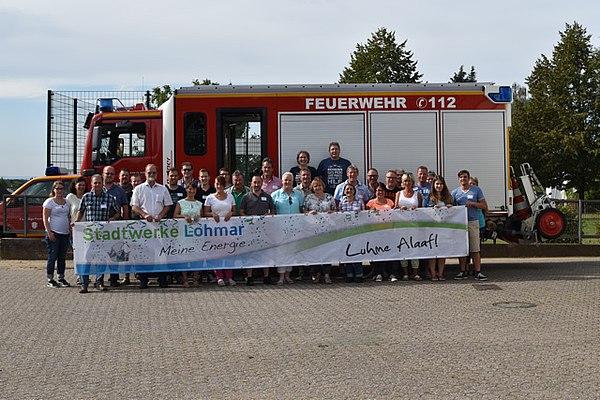 Das designierte Zweigestirn Ute und Frank Laufenberg (hinten oben) mit Gefolge und Michael Hildebrand, Geschäftsführer der Stadtwerke Lohmar (vorne, 2.v.l)